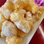 Cruller Puff coated with Powdered Sugar